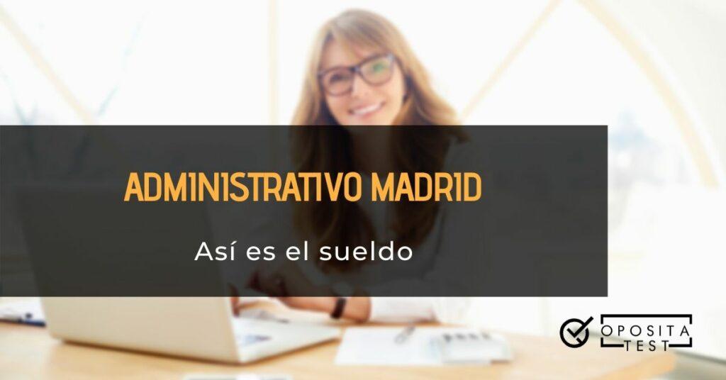 Imagen genérica de personas con cabellos de color claro y lentes de pasta negra trabajando en ordenador portátil blanco para acompañar una información en la que se analiza el sueldo de los administrativos de la Comunidad Autónoma de Madrid