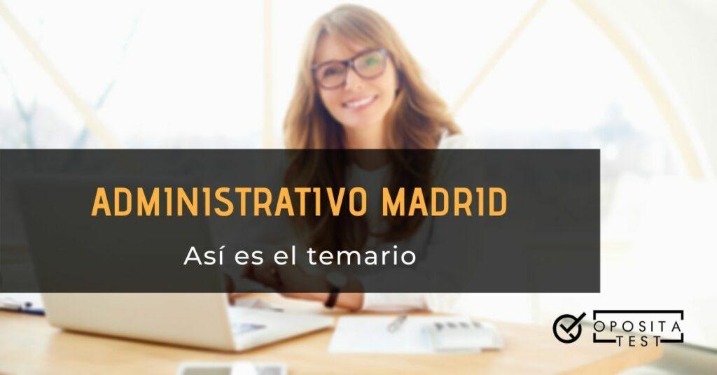 Imagen genérica de persona con cabellos de color claro y lentes de pasta negra trabajando en ordenador portátil blanco para acompañar una información en la que se analiza el el temario de la oposición a administrativos de la Comunidad Autónoma de Madrid