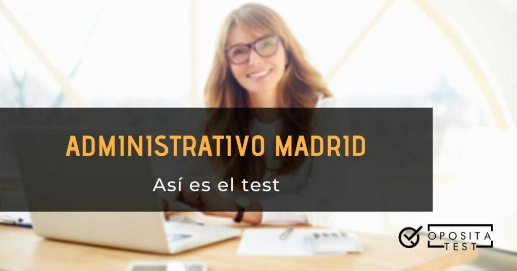 Imagen fuera de foco de profesional en entorno de oficina con cabello largo y lentes de pasta negra usando ordenador portátil blanco para acompañar una entrada en la que se analiza la estructura del test a Administrativo de la Comunidad Autónoma de Madrid