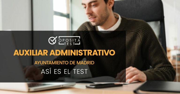 Hombre manejando un portátil con una mano y con la otra tmando notas en un cuaderno. Toda la imagen está fuera de foco. Se utiliza para ilustrar una entrada sobre el test de Auxiliar Administrativo del Ayuntamiento de Madrid.