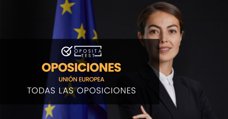 Mujer vestida con una americana negra y una camisa blanca con los brazos cruzados junto a una bandera de la Unión Europea. Toda la imagen está fuera de foco. Se utiliza para ilustrar una entrada sobre qué oposiciones hay en la Unión Europea.