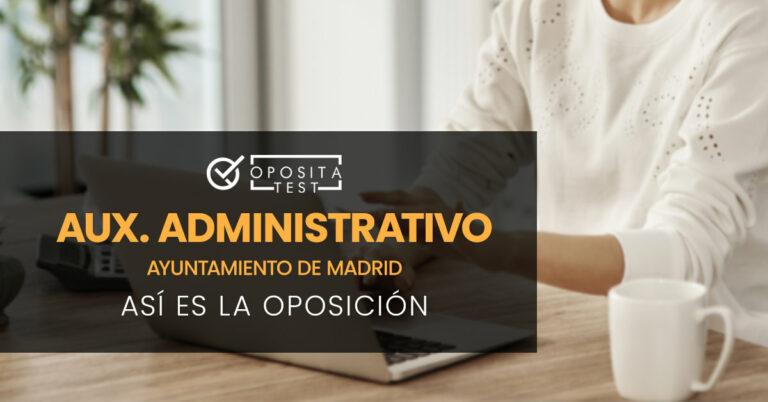 Mujer sentada tecleando en un ordenador portátil. Toda la imagen está fuera de foco. Se utiliza para ilustrar una entrada sobre cómo es la oposición de Auxiliar Administrativo del Ayuntamiento de Madrid.
